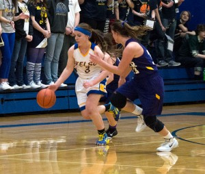 Kelso's Kady Bruce drives down the court against Columbia River in the Lassies' big Senior Night win Feb. 6.