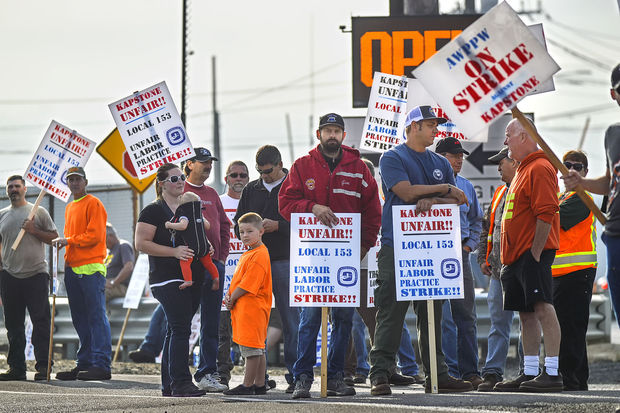 Striking members of AWPPW Local 153 and their families man the picket line outside the KapStone pulp and paper mill in Longview after the union went on strike at 3 a.m. Aug. 27. Photo by Brooks Johnson.